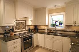 off white kitchen cabinets with black countertops. Unique White Antique White Kitchen Cabinets With Black Granite Countertops Intended Off With I