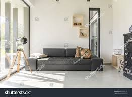 living room with black furniture. white living room with black furniture and window