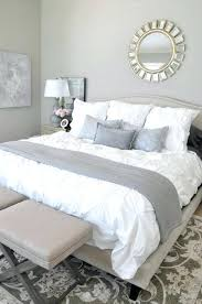 white comforter with grey trim y4032 neutral master bedroom white bedding with neutral rug grey accents abstract art white comforter grey trim