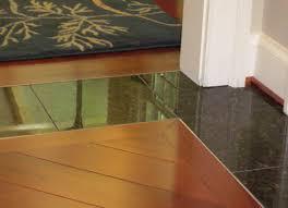 wood flooring details brazilian cherry floors with granite tile border for flush transoms