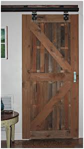 diy interior sliding barn door on the to separate pantry laundry room from