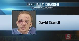 Driver in Police Chase Charged With 13 Crimes