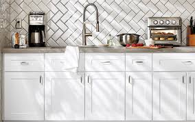 white kitchen cabinets with sink and appliances