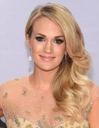 carrie underwood news pregnant singer dishes on writing single beautiful new