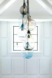 coastal glass pendant lamps farmhouse dining room with whitewashed ceiling planks shingle