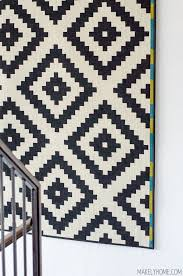 how to hang a rug on a wall via makelyhome com