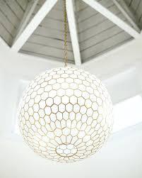 capiz chandelier chandelier chandeliers honeycomb chandelier capiz chandelier pier 1 west elm capiz chandelier installation