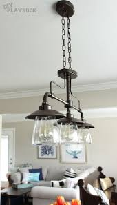 trio of industrial lights from loweu0027s over this wooden dining room table lighting fixture n17 fixture