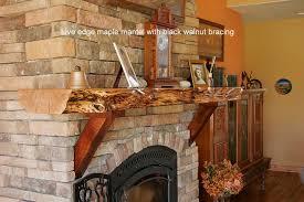 live edge maple fireplace mantle with black walnut bracing