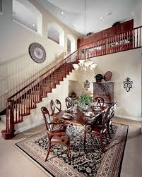 the dining room in this barcella model is separated from the kitchen and family room by