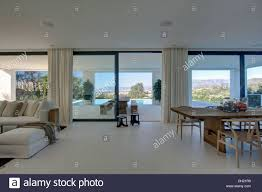 Open Plan Living Room White Flooring In Large Dining And Living Room In Open Plan