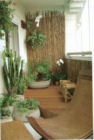 small balcony furniture. Transform Your Balcony Into A Mini Garden You Can Do This With Help From An Array Of Potted Plants Wooden Chairs And Bamboo Walls Small Furniture