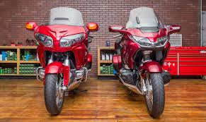 2018 honda wing. plain wing at 833 lbs full of gas the 2018 gold wing tour is claimed by honda to be  90 pounds lighter than 2017 model that loss weight will pay dividends in  on honda wing