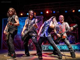 Warrant Performing At The Nutty Brown Amphitheatre In Austin