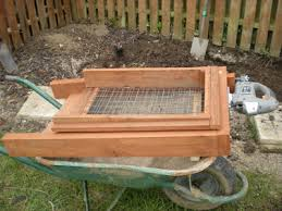 made from timber with the sifting box running on kitchen drawer rails it is powered by a tesco jigsaw and is self cleaning with larger bits