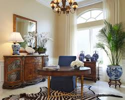 ginger jar lamps home office traditional with animal hide rug antique credenza arch window beige walls animal hide rugs home office traditional