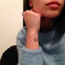 Wrist Tattoo Of The Greek Letter Omega On Kimberly