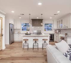 white kitchen cabinets with hardwood floors
