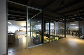 warehouse office design. Unique Warehouse View In Gallery Gray And Transparent Sliding Glass Doors Create Dynamic  Interiors And Warehouse Office Design