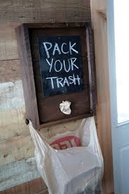 plastic grocery bags can be stuffed in from the top bags can be dispensed out the front and two knobs can be used to hold the bag up when in use as