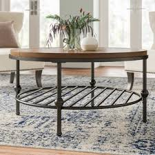 Its unique oval design is expertly crafted with solid mango wood and finished with an oak finish. Coffee Tables Joss Main