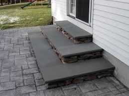 Stamped concrete patio with stairs Back Yard Pennsylvania Fieldstone Risers With Bluestone Treads Sit Atop An Existing Stamped Concrete Patio Twin Falls Concrete Contractor Entrances And Steps Landscaping In Ma Natural Path Landscaping