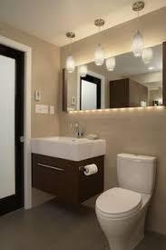 bathroom lighting above mirror. long mirror above sink and toilet lighting is amazing bathroom