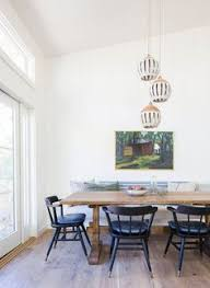 what a gorgeous dining room so much natural lighting such pretty chairs and