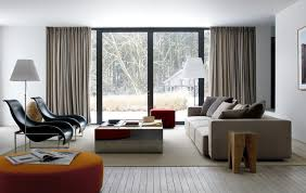 brown sofa design for large living room design ideas with wooden flooring design and glass door