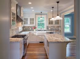 example of a country l shaped medium tone wood floor eat in kitchen design