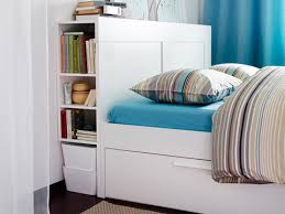 IKEA Brimnes bed and headboard with storage.