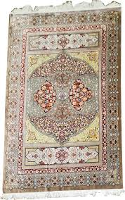 traditional persian qume silk rug with signature