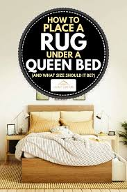 how to place a rug under a queen bed