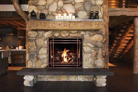 a fullview décor fireplace with antique copper stella front and norway spruce fire base adds elegance and a real log fire look to a grand rustic cabin