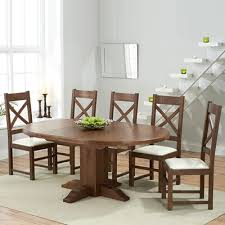 trina dark solid oak round extending dining table with 6 croydon chairs 7258
