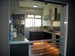 Design Ideas, Fashionable Sliding Glass Door Separate The Kitchen That  Equipped With Stylish Furniture Sets