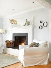 cozy fireplace ideas whether it s framed by wood or white painted bricks a fireplace