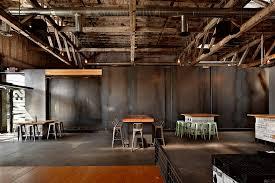 Trendy concrete floor wine cellar photo in Perth with storage racks