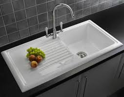 hard to find but here s one a ceramic drainboard sink