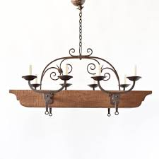 rustic wood beam chandelier from belgium with forged iron arms