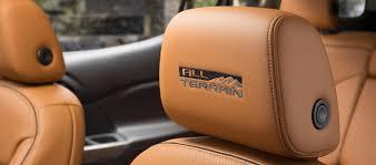 2018 gmc acadia all terrain interior logo featured on front seat headrests