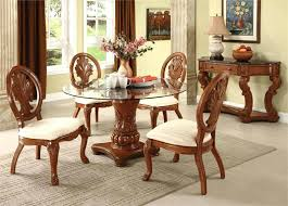 wooden dining table with glass top glass round table with crafted wood base four wooden chairs wooden dining table with glass