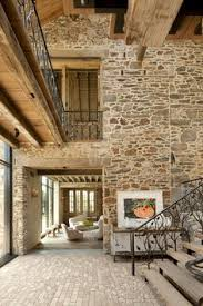 Small Picture Stone Walls Cathedral Rafters lend Old World Timelessness to