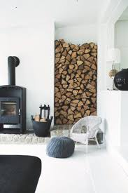 Simple fireplace with modern surroundings - the woodpile-niche is a cool  detail and together