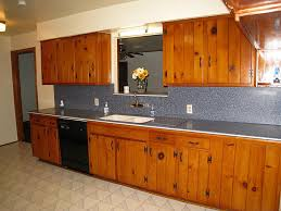 before and after painting knotty pine kitchen cabinets painting knotty pine cabinets image permalink