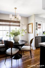 Captivating Located Beside A Navy And White Kitchen, This Gorgeous Dining Room Boasts A  Glossy Round Black Dining Table Lit By A Vendome Small Chandelier And  Surrounded ...