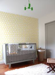 ... Beautiful wallpaper brings yellow while the crib adds gray to the  modern nursery [Design: