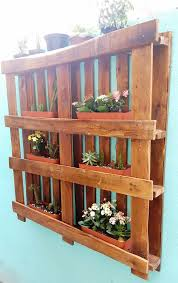 pallets hanging garden on wall