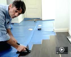 how to install flooring install flooring around kitchen cabinets