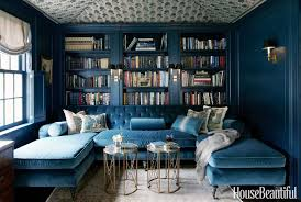 navy blue library with blue velevet sectional via house beautiful